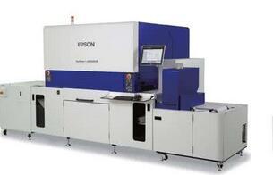 国内首台数码上光印刷机在洛研制成功
